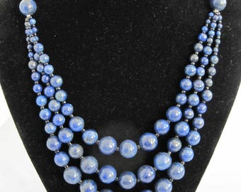 "Beautiful Lapis Lazuli real semi precious stone cascading necklace made with three strands of graduated sized round beads.  22"" 120g"