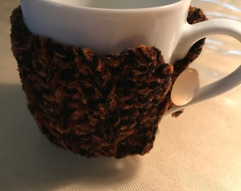 Crocheted coffe mug cozy