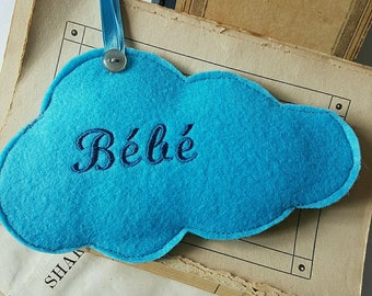 Door embroidered baby blue felt cloud cushion