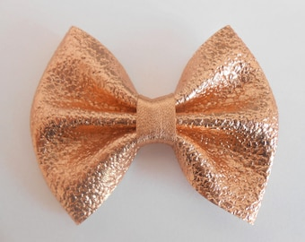 Rose gold faux leather bow 7 x 5.5 cm