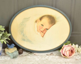 Oval framed baby illustration print from 1930's.