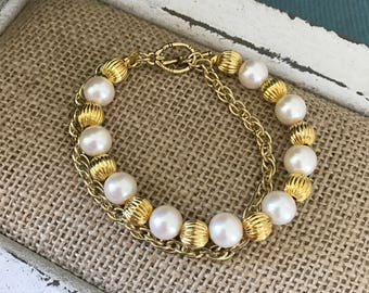 Gold & pearl double strand bracelet.