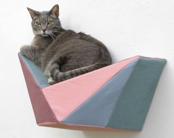 Cat shelf wall bed in deep mauve, dusty teal, blush and slate