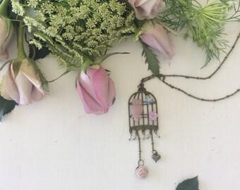 Mauve owl birdcage necklace