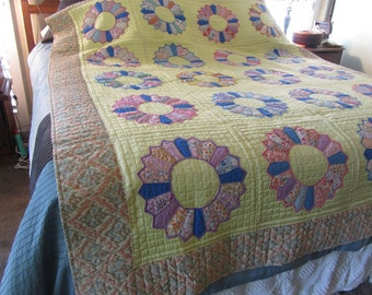 antique quilt, dresden plate, yellow, pinks, blues, hand quilted