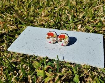 Red rosebuds and white flower stud earrings.