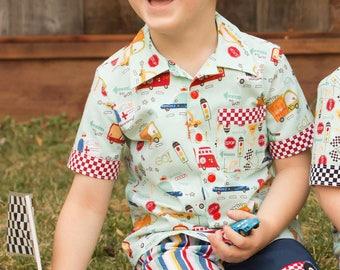 Boy's button down camp style shirt in 100% cotton. Race Car Theme Shirt