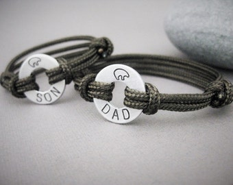 Father/Son matching stamped bracelets, Small Aluminum Disks Stamped with DAD and SON with a bear at the top, and adjustable paraline cord