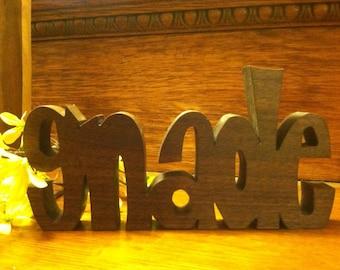 "Inspirational wooden words ""GNADE"" (German word for Grace)"