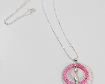 Pink long necklace with silver braided circle circle and swirl pendant