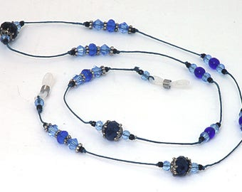 Faceted  Blue  Eye Glasses Lanyard, leash 26.5 inches long. Waxed Irish Linen Lanyard glass beads, sliver tone bead caps and spacers.