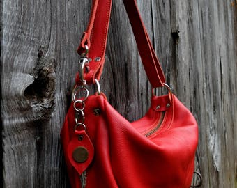 Red leather with asymmetric and convertible shoulder bag