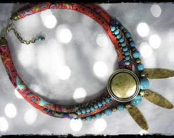 SOLD - Crew neck Gypsy - multicolored fabric red background (purple) - wood beads (teal) and metal