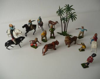Metal toys: Cowboys, Indians, lion, trees and more. Wild-west and Africa mix