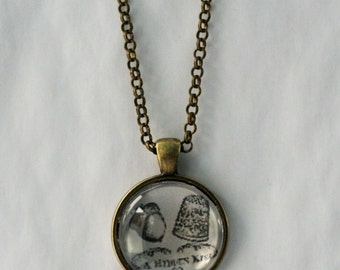 Thimble and Acorn Image Necklace - A Hidden Kiss in Antiqued Bronze and Brass Black and White