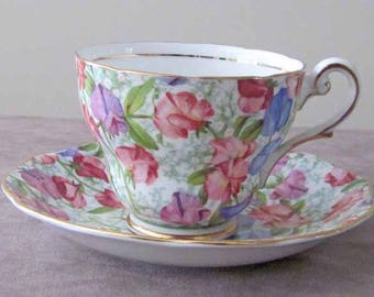 Pink, Purple and Green Chintz Teacup and Saucer with Gold Gilt by English Maker Royal Standard 1950's