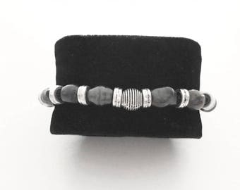 Unisex bracelet with dark grey metal beads