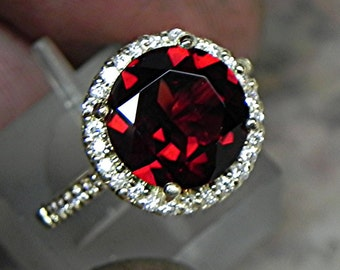 AAA Natural Red Pyrope Garnet   10mm  4.00 Carats   in 14K Yellow gold Halo ring with  .35 carats of diamonds 1811