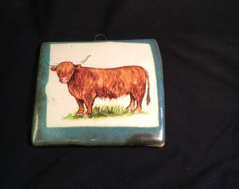 Handmade pottery stoneware tile with thistle