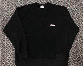 vintage Fila swatshirt nice condition..hip hop swag raptees..size medium