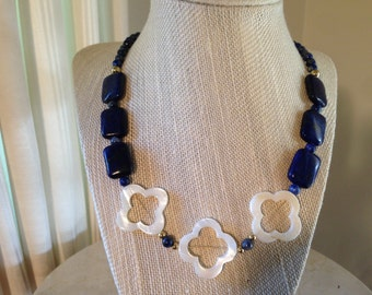 """20"""" Lapis Lazuli necklace with Quatrefoil shaped Mother of Pearl accented gold plated beads."""