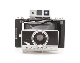 Polaroid Land Camera Model 180 and Accessories - uses fuji 100c or 3000b pack film - Guaranteed working