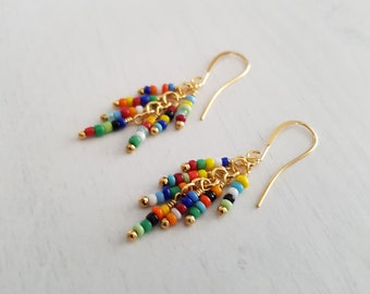 Multicolored beads, wire wrapped, gold plated cluster earrings.