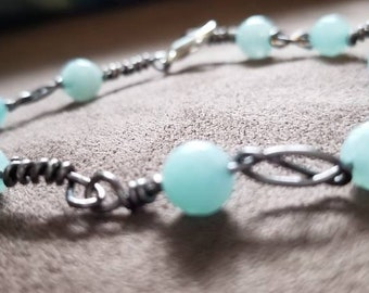 Silver wire and mint blue beaded bracelet