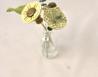 green button flower bottle bouquet