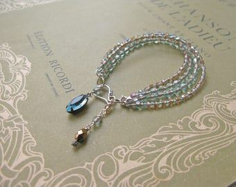 Charlottenburg 4-string bracelet in aqua