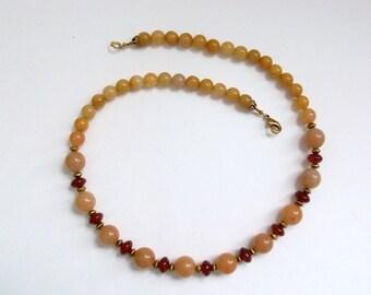"""Carnelian, adventurine, and jade. Genuine semi-precious beads of adorn this 18"""" necklace."""