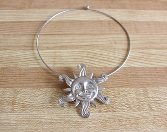 Vintage 1990's silver metal chocker with smiling sunshine pendant