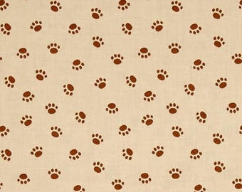 Riley Blake Rover.Paw tan .Riley Blake presents Rover and friends in a colourful cartoon dog print fabric.