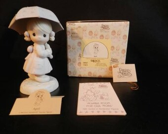 "Precious Moments ""APRIL"" Retired Figurine in Excellent Condition with original box"