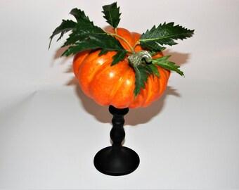 Orange Colored Ghord Autumn Decoration on Pedestal