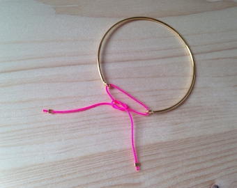 Bangle is plated 14 k - neon pink cord