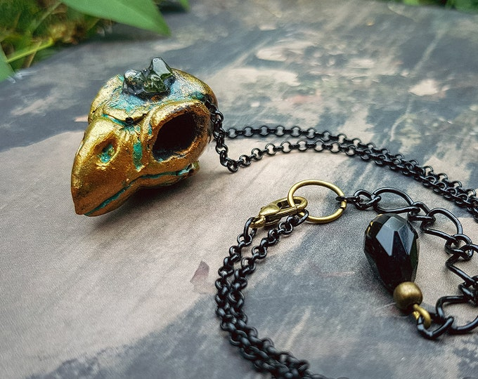 Sparrow necklace patina with green quartz crystals.