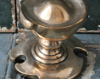 A bronze Art Nouveau door pull,