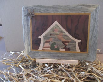 Nativity scene on canvas on easel