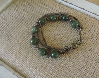 """Green and bronze triple strand.  Lovely bronze medallion by the lobster clasp.  8"""""""