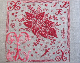 Floral embroidery letter X in pink and Red