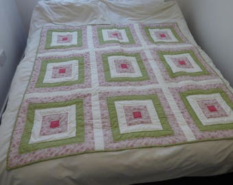 Patchwork quilt, single bed size, double bed topper or large lap quilt. Cream, green, pink and floral fabrics. Handquilted..