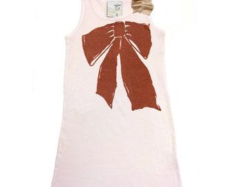 Girls rib tank dress in with shoulder ruffle and ribbon print.