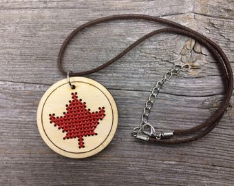 Cross stitch Canadian maple leaf pendant necklace medllion on faux leather with lobster clasp by Canadian Stitchery