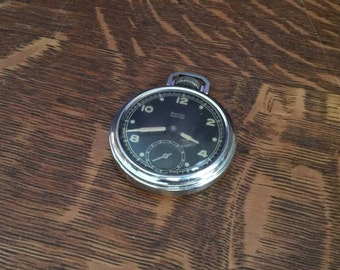 Working pocket watch 1950s vintage Pocket Ben by Westclox with black face and previously luminous dial