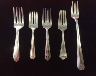 Set of 5 old silver plate baby forks