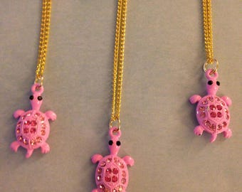 Three kids pink turtle gold plated necklaces