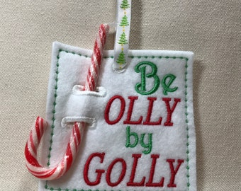 Candy cane holder, Embroidered 'Be jolly by golly'.