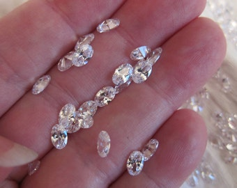 6mm x 4mm Cubic Zirconia Gemstones, White, Grade AAA, Pointed Back, Faceted, Oval - Available Individually, in Pairs and in Larger Pkgs