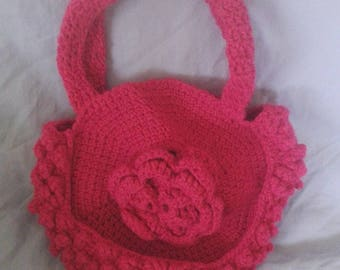 bag decorated with pink crochet d a big flower